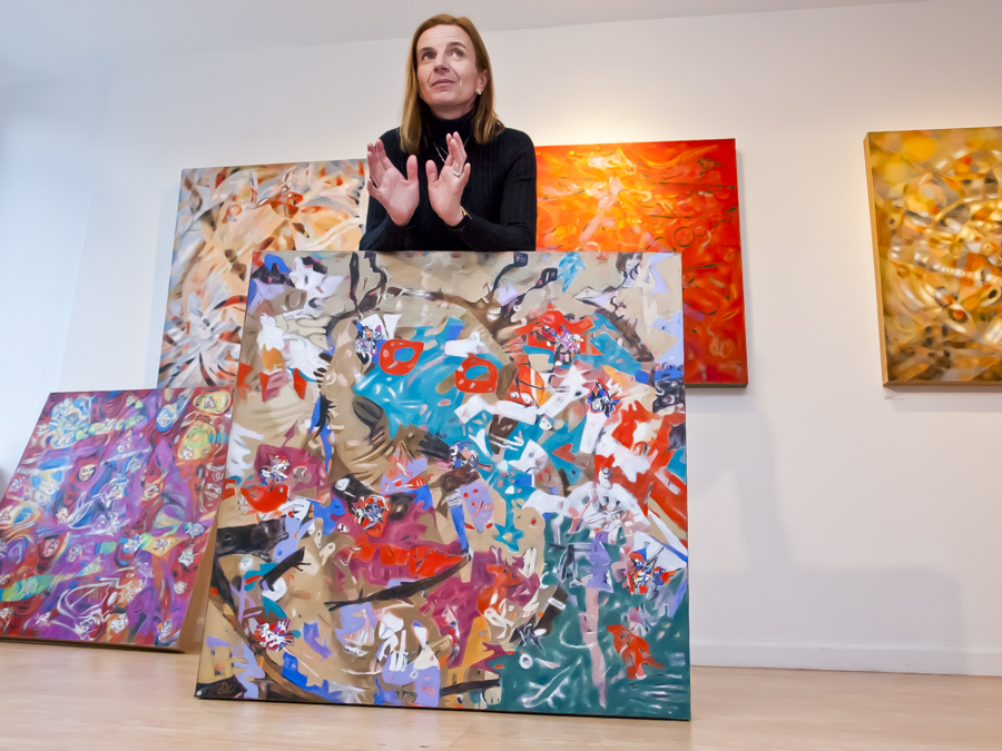 DORA TOMULIC discusses her 'Shaman' series paintings at the Blue Door Gallery on Feb. 23.