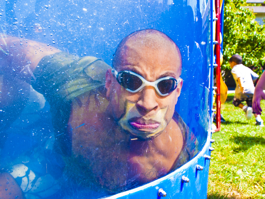ANDRÉS CUEVAS splashes into the dunk tank after a child hits the target, off camera, at Kids Rule Weekend at Lehman College on Aug. 3.