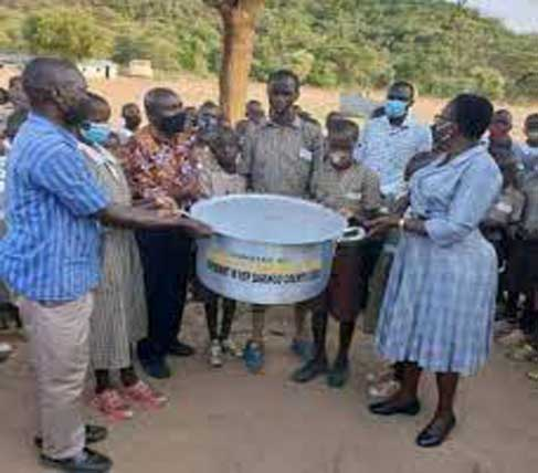 Reaction as Kenyan Politucian donates one Pot Branded with her name to a school