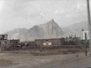 Vila dos Oito, logo atraz da montanha