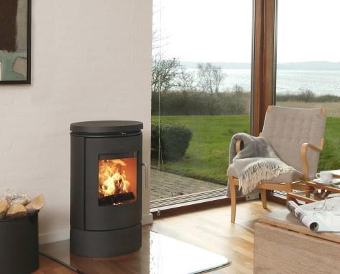 Morso 6140 wood burning stove on glass plinth on wooden floor