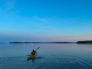 sea kayaking at sunset on webb cove in stonington maine