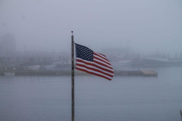 american flag fog stonington maine harbor