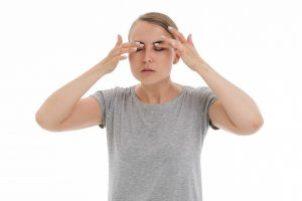 Woman Holding Eyes