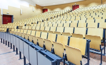 Picture of a university classroom with tiered seating