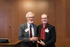 Biochemist Christopher Mathews receives Lifetime Achievement Award in Science from College of Science Dean Roy Haggerty.