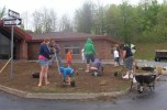 Pictured are the parents and their children hard at work during the planting at Seneca Manor.