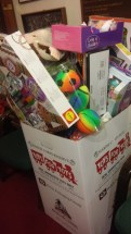 Visitors of the John Wells Pratt House Museum during the Parade of Trees filled a Toys for Tots box with new, unwrapped gifts to donate to local children in need this holiday season.