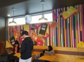 Customers enjoy the grand opening of Fulton's Taco Bell.