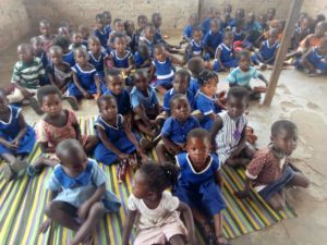 FCUBE:Atebubu Fakwasi Presby Basic School pupils study on bare floor 2