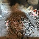 Cooking Peka, a traditional Croatian dish
