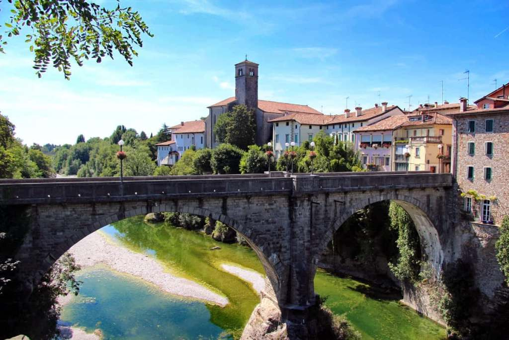 A picturesque town over looking a bridge.