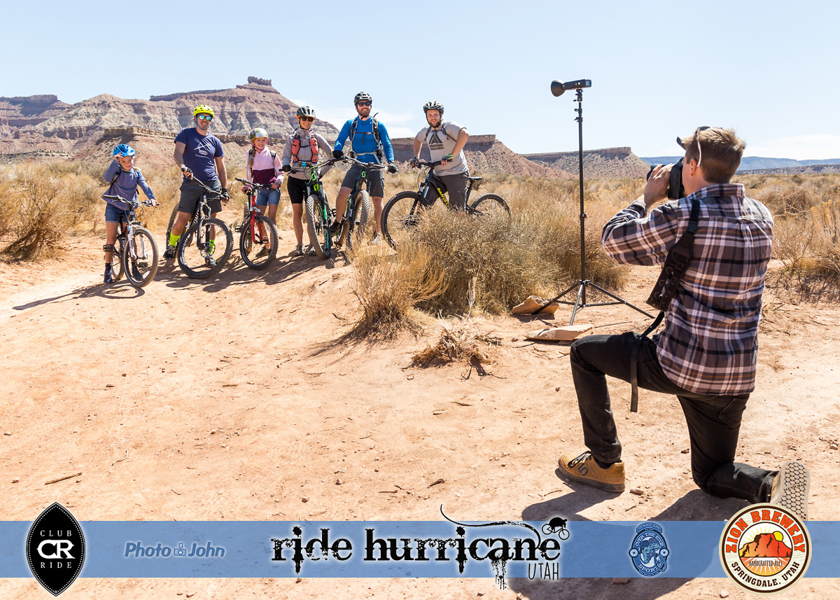 A photographer takes a picture of a family of mountain bikers in the Southern Utah desert.