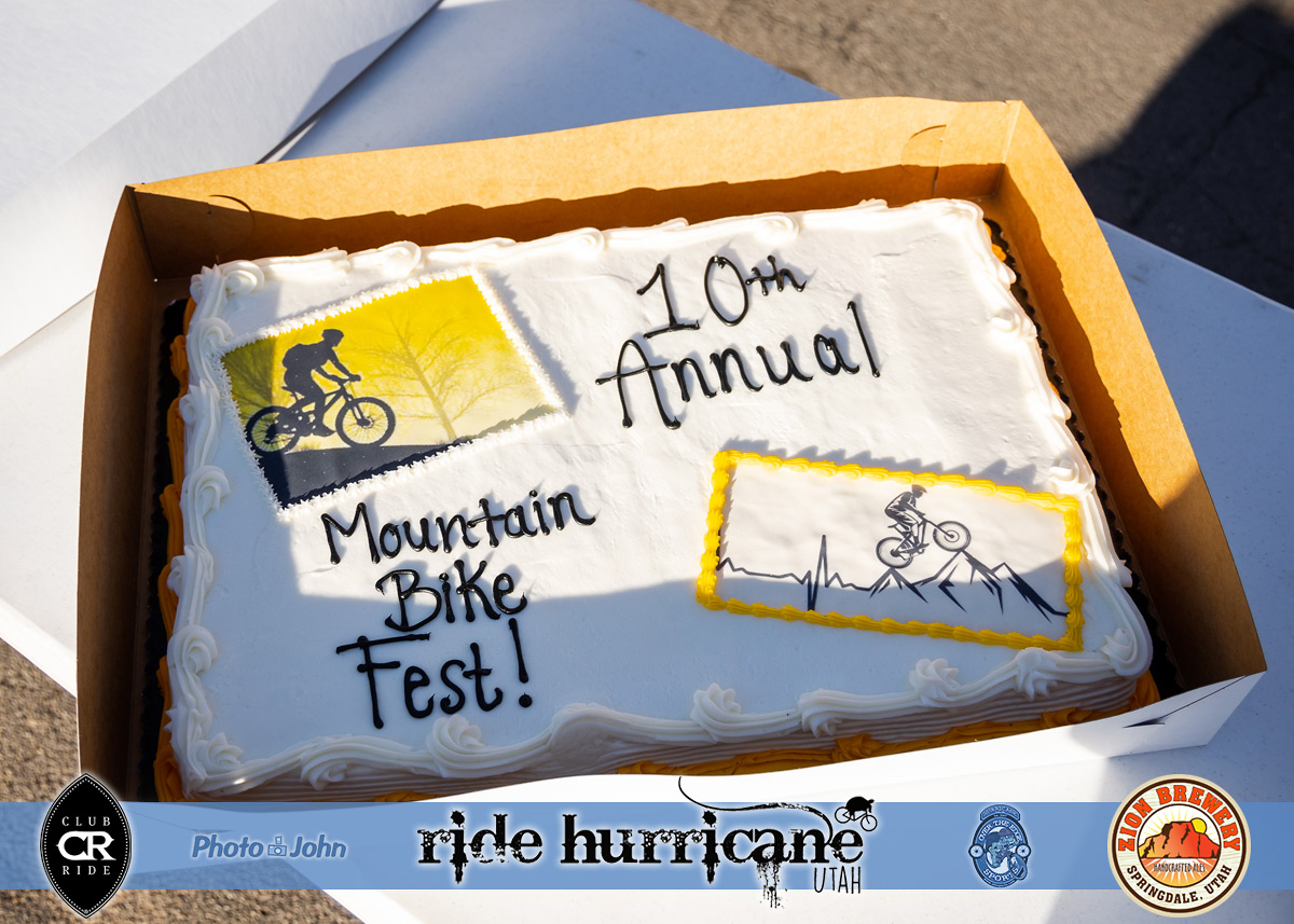 Sheet cake with mountain biker decorations.