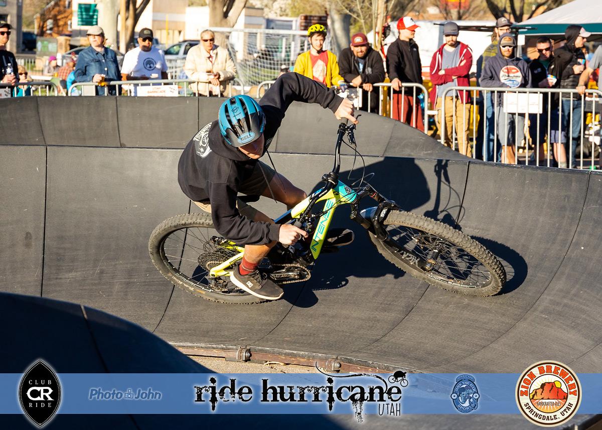 Mountain biker cornering hard on a pump track
