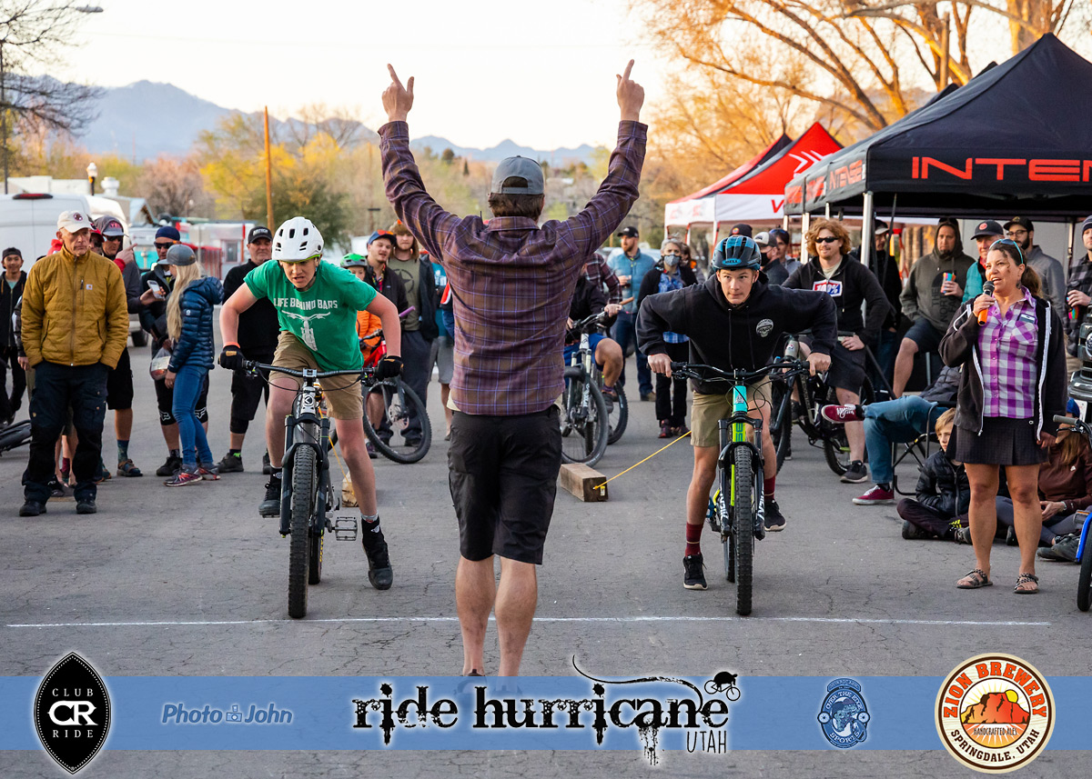 Two cyclists at a mountain bike log pull race start