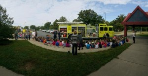 Member's showing Engine 63 to a group of kids for Fire Prevention Week.