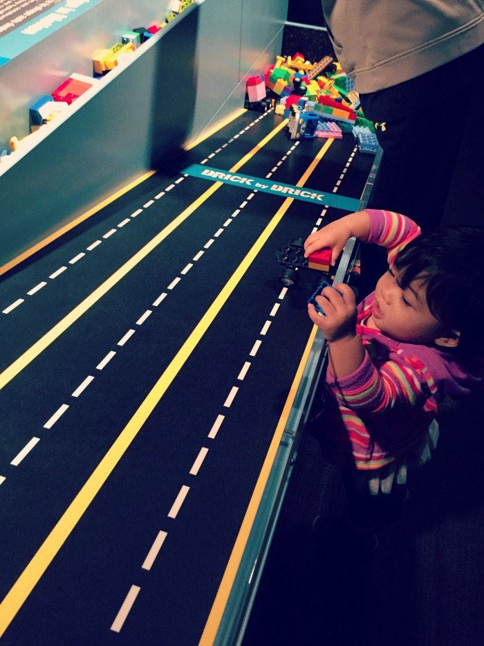 Kids can race their LEGO creation down the ramp at the Museum of Science and Industry's Brick by Brick exhibit.