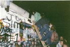 East Germans scaling the Berlin Wall