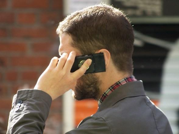 Man_speaking_mobile_phone_debt_collectors