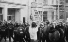 An anti-poll tax protestors confronts police.