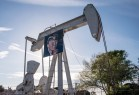 An oil pump featuring Donald Trump's picture.
