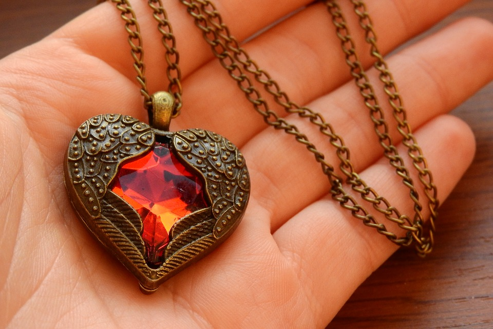 A talisman can be a heart pendant used to draw love to its wearer.