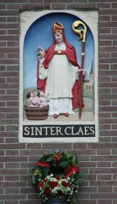 Saint Nicholas appears to help the christmas witch in the tale of the baker's dozen.