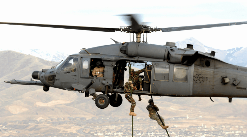A Utah National Guard Soldier and 19th Special Forces member are lifted on board an HH-60 Pave Hawk during a combat search and rescue integration exercise Nov. 9 over the Utah Test and Training Range.
