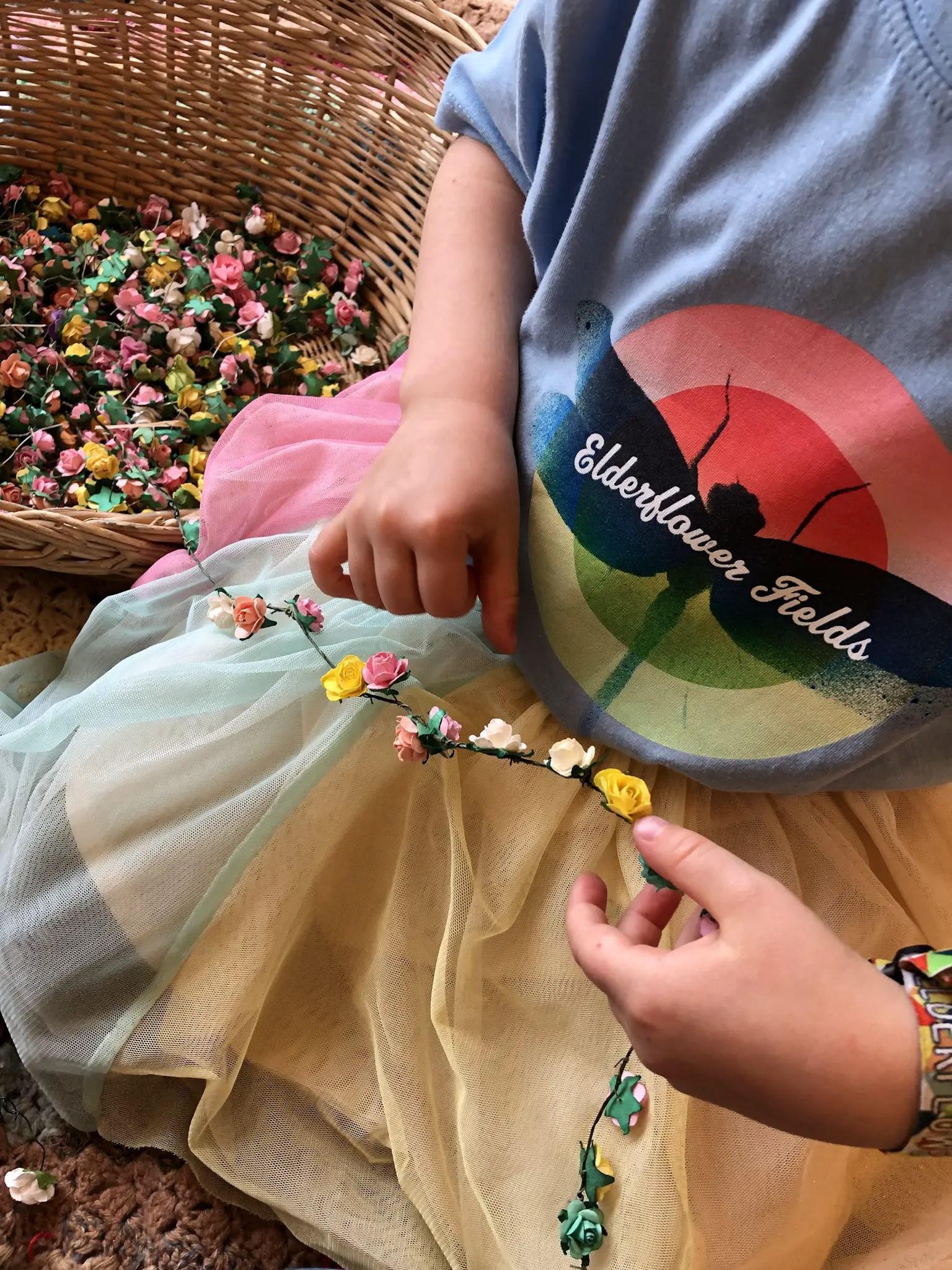 making flower headband garlands at elderflower fields festival 2019