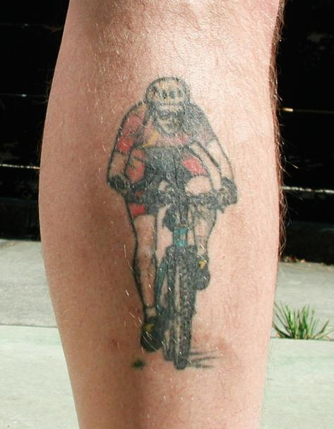 me and my mountain bike, on the outside of my right calf