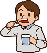 中年男性が歯のケアをしている画像