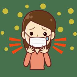 抗花粉用の大きなマスクをつけながらくしゃみと涙が止まらない女性の画像