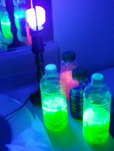some of the bottles that were filled with glowing liquid
