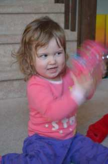 Mary shaking her gift from Santa. I don't know where she picked this up... photo by Diskdaddy.com