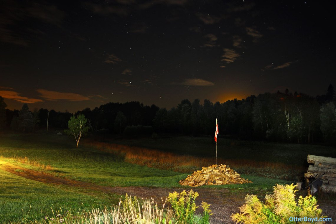 night photography stars and setting moon over fields