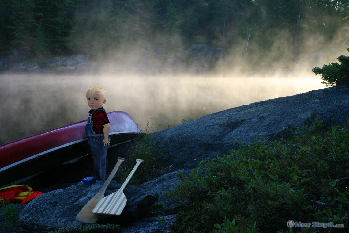Otter Boyd boy with canoe at misty morning lake