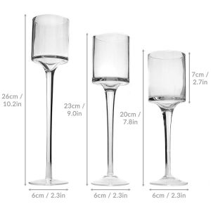 Set of 3 Tall Elegant glass tea light holders. ELEGANT - These modern & stylish candle holders add the perfect highlight to your Wedding or event decor. The unique design will complement any environment due to its appealing and eye-catching design. These elegant candlestick holders are ideal for tea lights & candles under 6cm in diameter, they will also fit LED candles & tea lights. 3 Sizes: Small: 20cm (H) Medium: 23cm (H) Large: 26cm (H) Diameter: 6cm