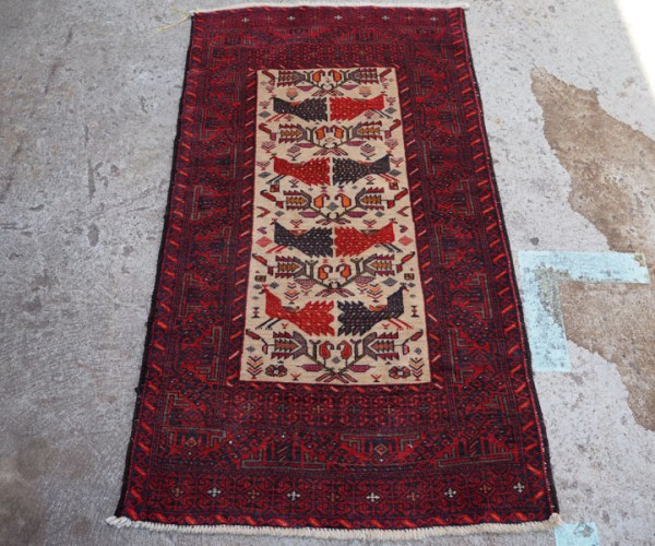 Hand knotted wool on wool carpet from Belouchistan, approximately 60 - 70 years old