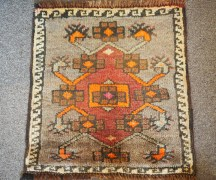 Hand knotted wool on wool Small table mat from Anatolia, approximately 60 years old
