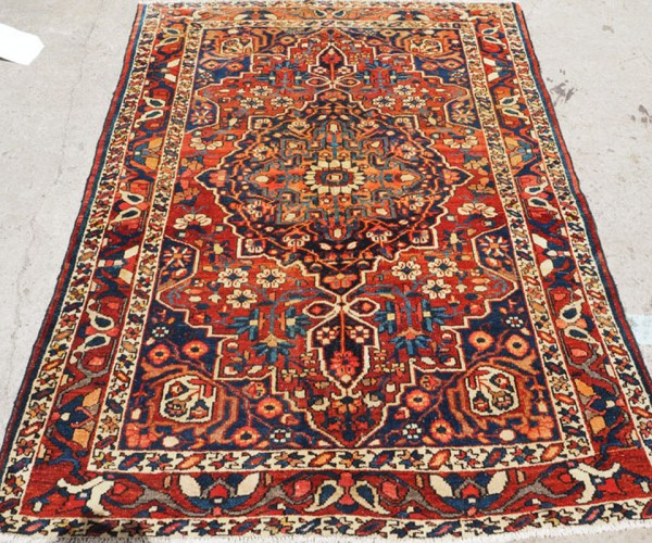 Hand knotted wool on cotton Persian carpet from Husseinabad, approximately 50 years old
