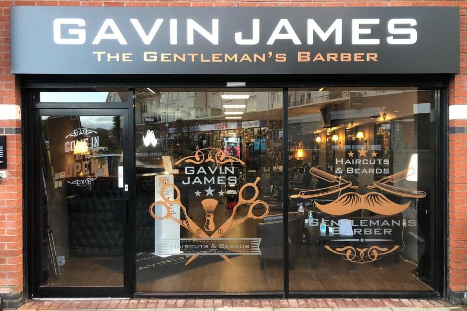 New Shop front sign with illuminated letters and window graphics