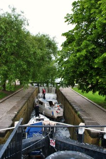 Boats moving into the higher chamber of the 2nd Lock. The lock keepers were doing the double locking stunt... note the cascade ovr the upper sill...