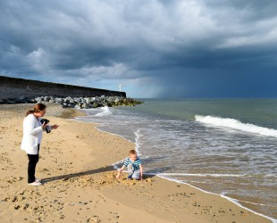 South Beach Arklow... there's a storm brewing in the distance! Sunshine and sand... lad's bliss!