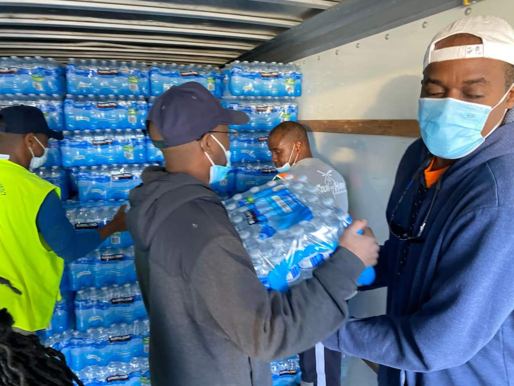 At the Oakwood University Seventh-day Adventist Church in Hunstville, Alabama, volunteers load donated water bottles into a truck bound for Texas. Photo provided by Oakwood University Church