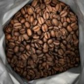brown coffee beans on white plastic pack