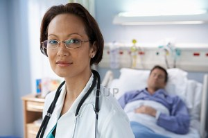 Female doctor with patient in background