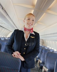 Female flight attendant smiling