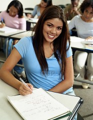 Female student at a desk smiling