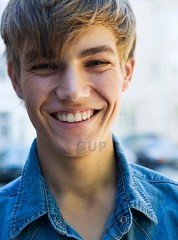 Male teenager smiling confidently